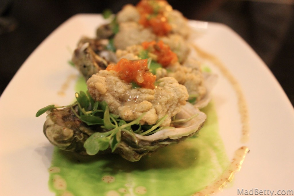Crispy Gulf Oysters with arugula, tomato chutney, and a pickled shallot vinaigrette