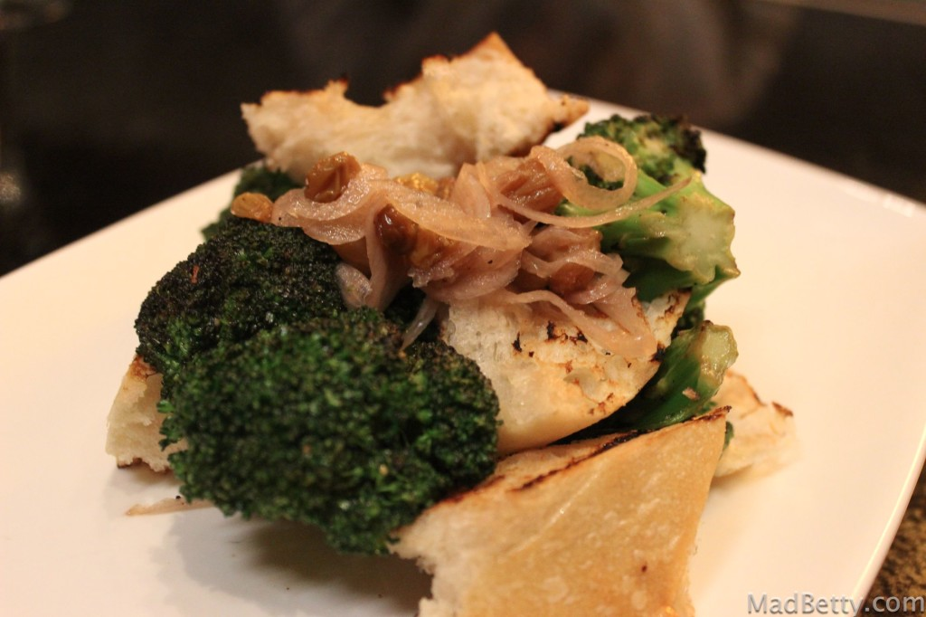 Grilled broccoli and sourdough bread with pickled shallots and golden raisins