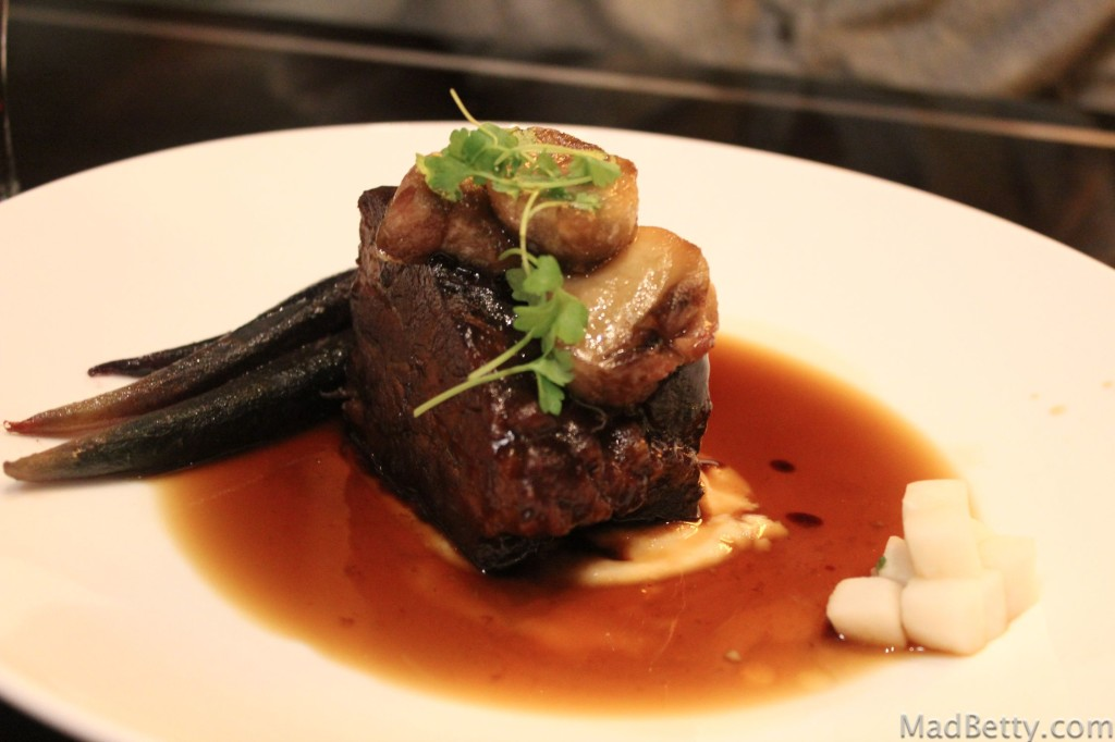 Beef short rib with roasted bone marrow, fall root vegetables, and beef consomme