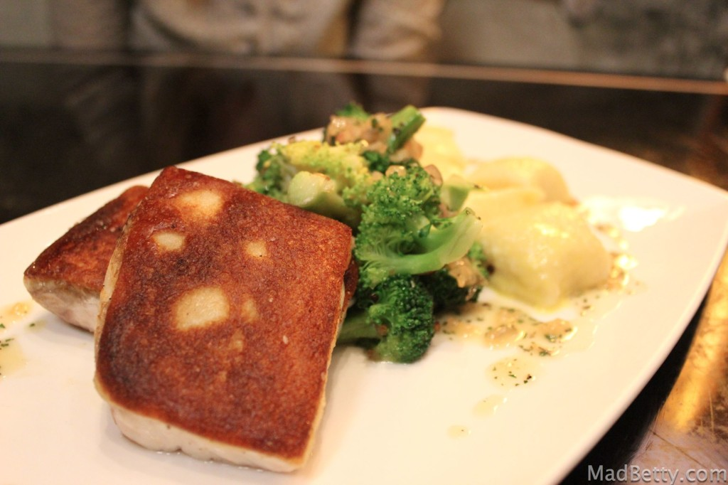 Sourdough crusted striped bass, broccoli, and ricotta gnocchi