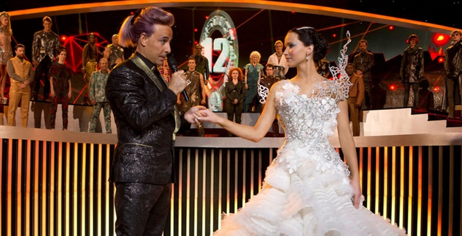 Stanley Tucci as Caesar Flickerman and Jennifer Lawrence as Katniss Everdeen in Hunger Games: Catching Fire