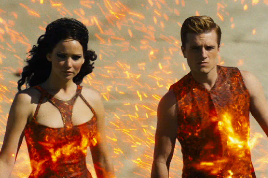 Jennifer Lawrence as Katniss Everdeen and Josh Hutcherson as Peeta Mellark in Hunger Games: Catching Fire